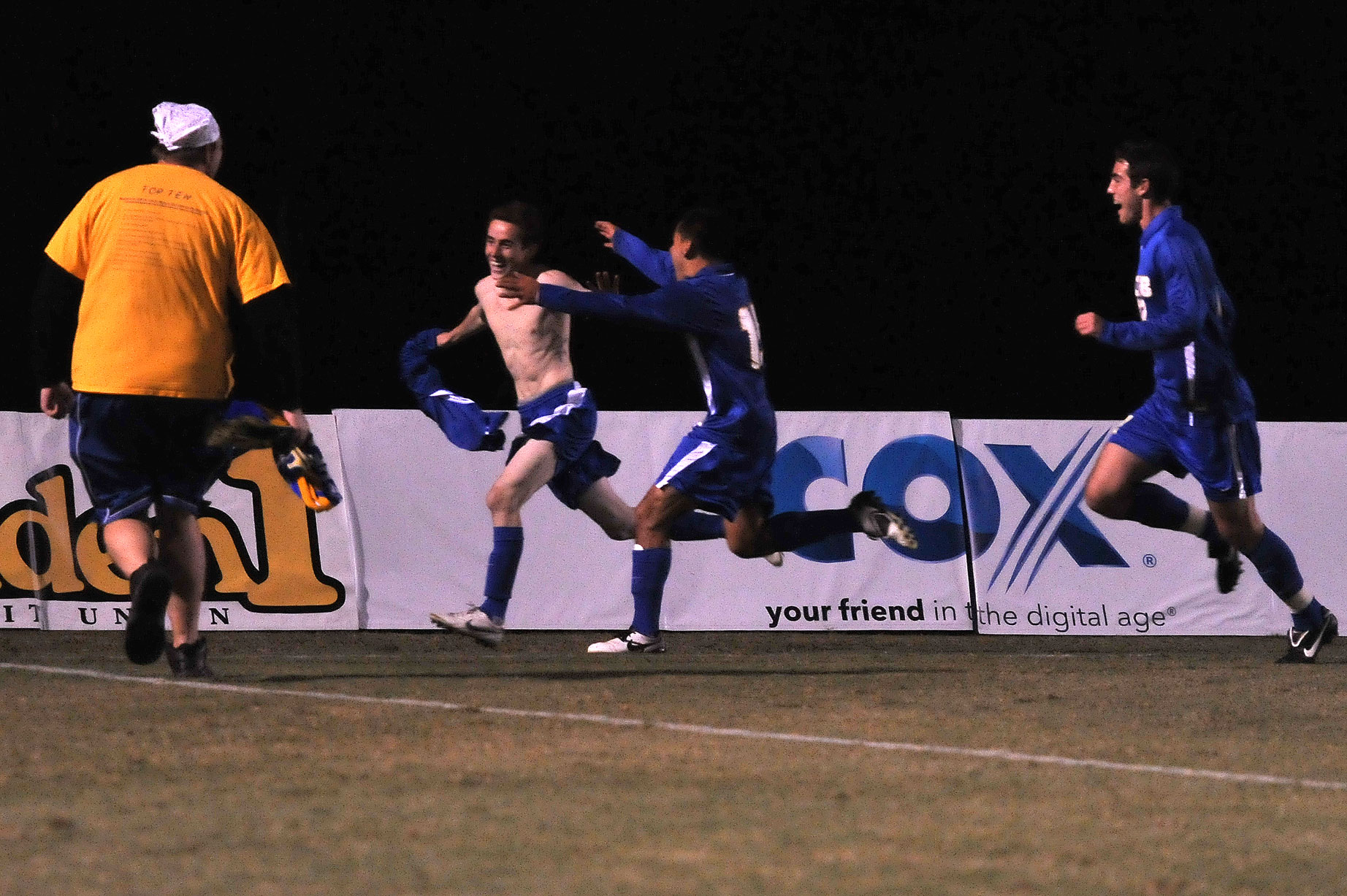 Celebrating after scoring the winning goal, Nic Ryan prepares to get mugged by the onrushing UCSB crowd.