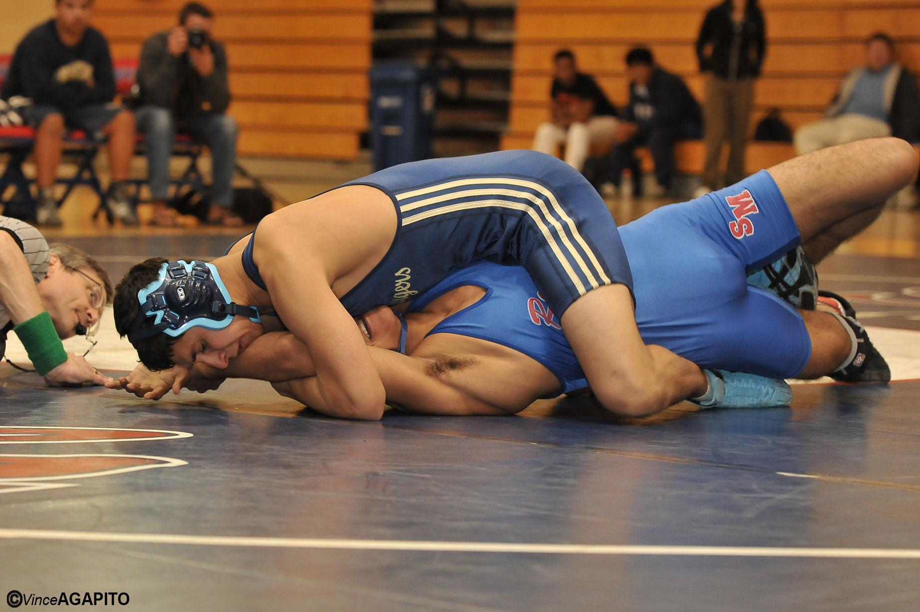 DP's Brandon Velazquez pins his San Marcos opponent.