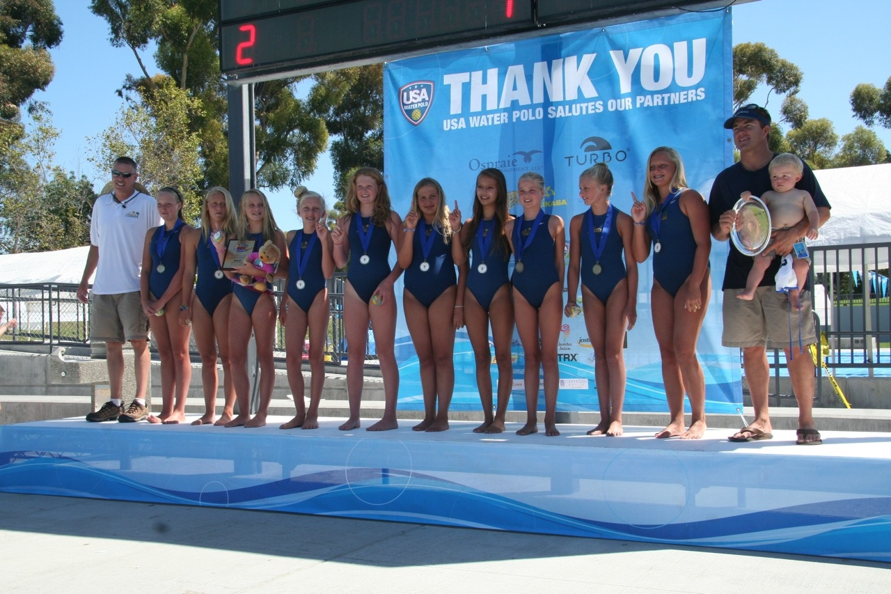 Coach Roth's 12-and-under girls club team stand at the top of the National Junior Olympics podium in 2011.