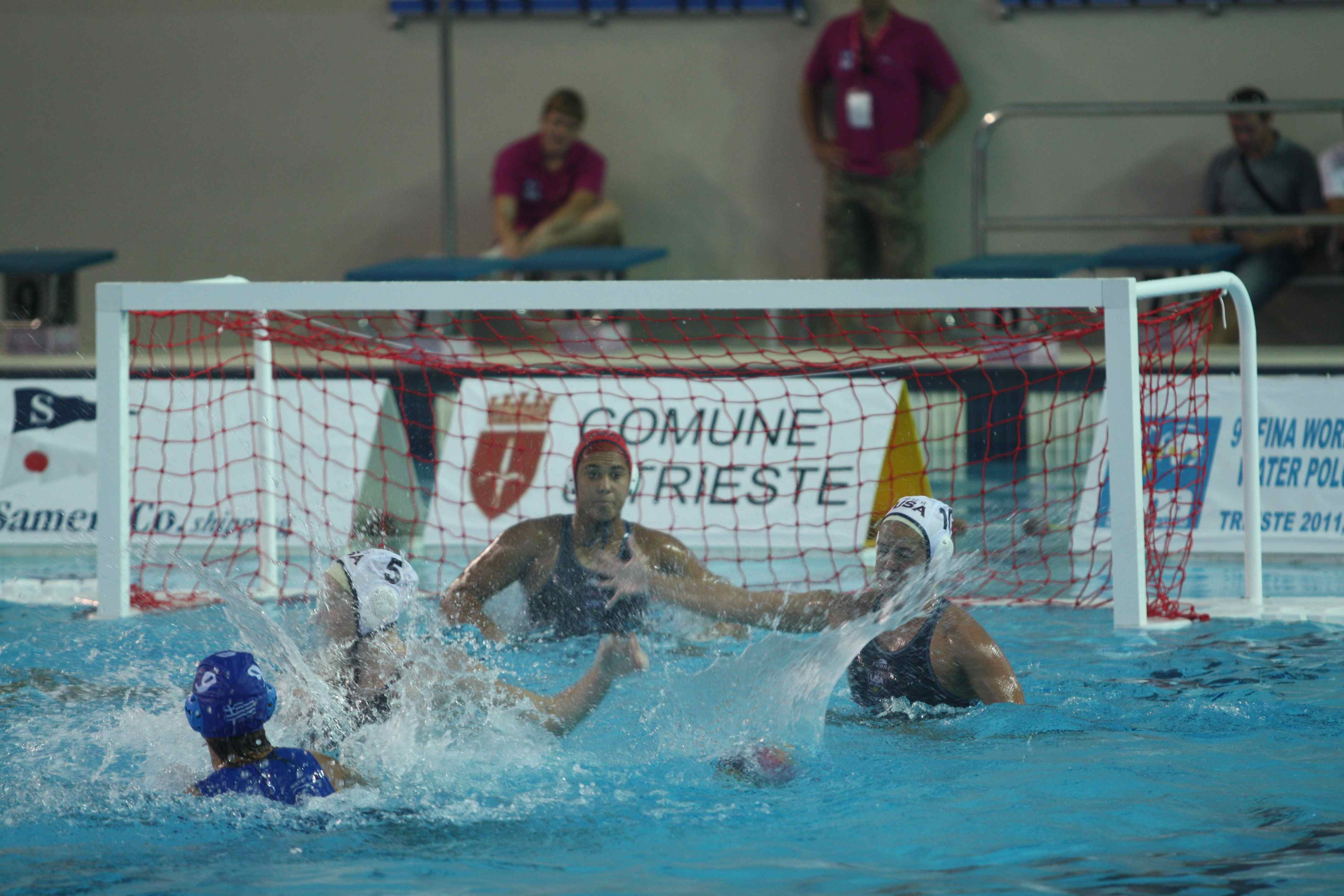 Goalie Sami Hill and Kiley Neushul, right, defend during match against Greece at the FINA Women's Junior World Championships in Italy. (Photo by Peter Neushul)