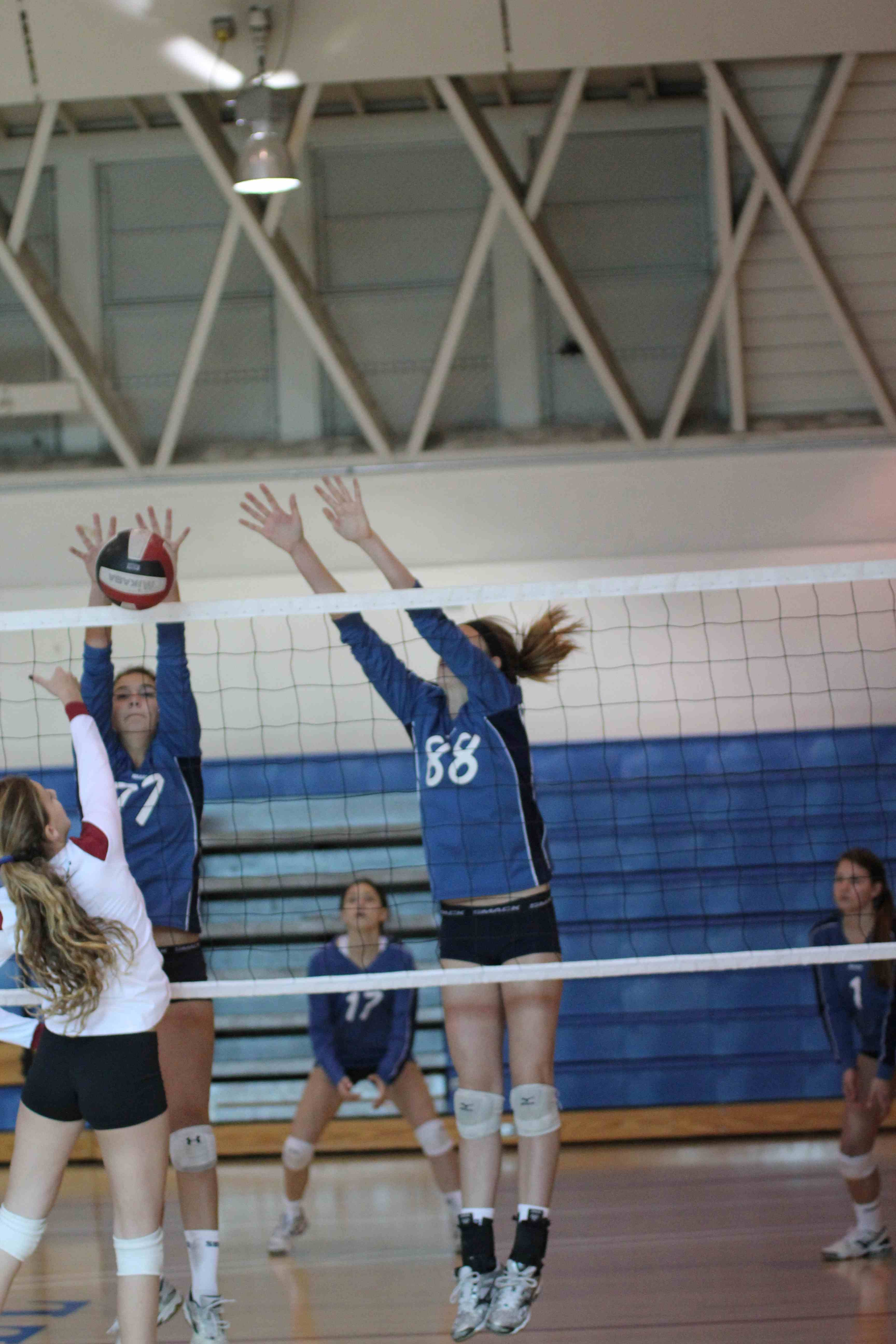 Emma Harrah, left, and McKenna Goss combine on a block for the Santa Barbara Volleyball Club's 15-Smack team.