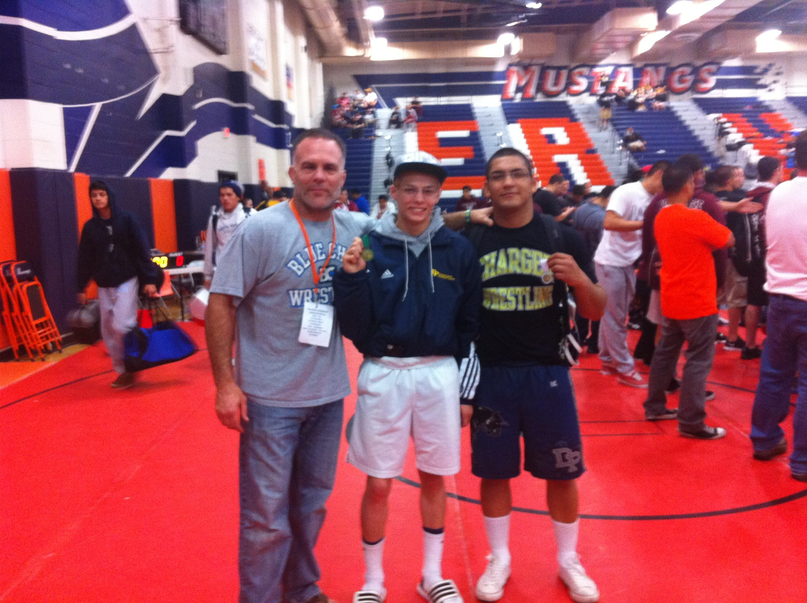 Dos Pueblos coach Anthony Califano is sending wrestlers Chad Lampe, center, and Yaskin Solano to the CIF Masters Meet.