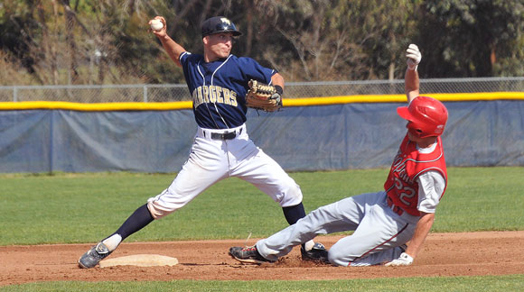 Dos Pueblos second baseman xx xx tries to turn a 6-4-3 double play but the runner beat the throw to first.