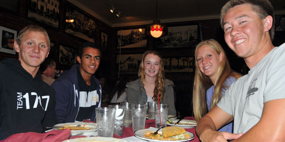 Members of the Dos Pueblos swimming teams, including Athlete of the Week Alex Valente, far left, at Monday's luncheon.
