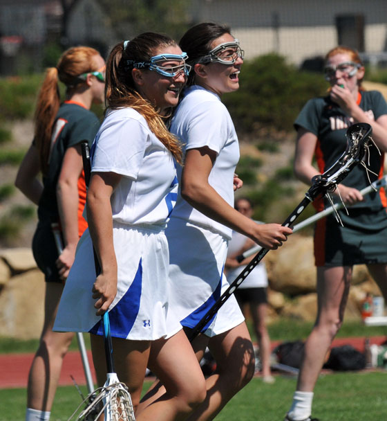 Annie Weis, left, and Alexis Hill, right, are all smiles after one of Hill's six goals.
