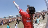 Lakey Peterson is carried up the beach in front of thousands in Huntington Beach after winning the U.S. Open of Surfing
