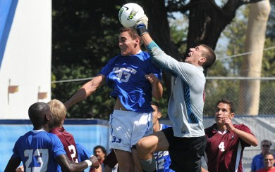 UCSB's Charlie Miller rises above the fray only to have Harvard keeper Joe Festa knock the ball away from danger. The Gauchos' men's soccer team remains undefeated going into October.