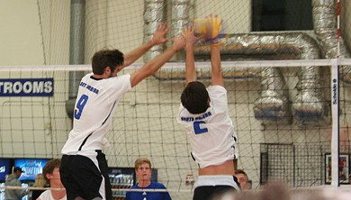 Quinn Denkensohn (9) and Chris Newton (2) double block Vegas