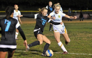 Santa Barbara High's Natalie Cvitanic hounds a Buena player in the midfield on Tuesday. (Presidio Sports Photo)