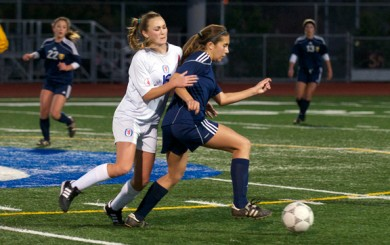 San Marcos' xx tries to slow down Dos Pueblos' Lauren Van Valkenburgh in the midfield.
