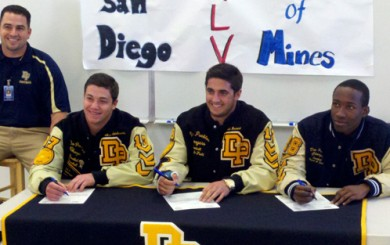 Dos Pueblos seniors Anthony Spiritosanto, Nico Bornand and Jordan Degraffinreid, with head coach Nate Mendoza, at Wednesday's signing ceremony.