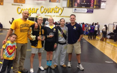 Three Dos Pueblos wrestlers won Channel League titles on Saturday at the league finals. Posing after the tournament are Joseph Lampe, assistant coach Ati Conner, 120-pound champion Chad Lampe, 113-pound champion Cameron Cox,and 126-pound champion Nico Sorenson, and head coach Anthony Califano.