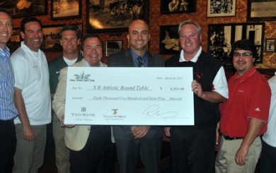Rich Nihaus presents a check to the local high school golf programs on Monday. (Presidio Sports Photo)