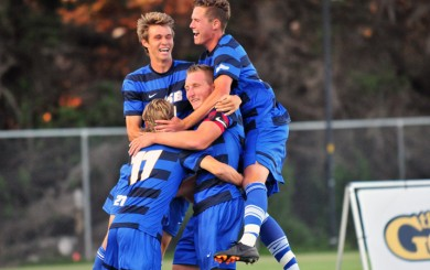 Achille Campion is mobbed by his UCSB teammates after scoring at the 3:06 mark of the game.