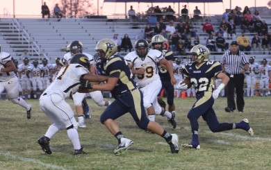 Dos Pueblos running back Tyler Welch runs behind Micah Ruiz during the Chargers' 31-21 victory. Welch scored three touchdowns. (Photo by Katie Issaris)