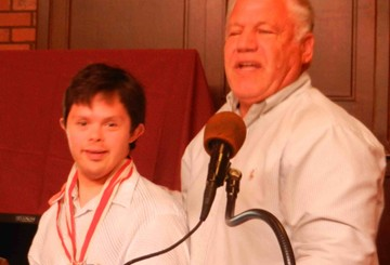 Santa Barbara Special Olympics soccer coach Jerry Siegel introduces the Athlete of the Month, Matt Meisel.