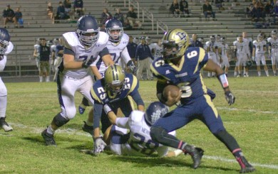 Leshon Bell of Dos Pueblos looks for running room against San Juan Hills. (Photo by Katie Issaris)