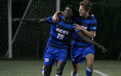 Ismalia Jome and Duncan Backus celebrate after Jome scores against the Hornets( Wade Carr )