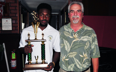 Santa Barbara's Cheroke Cunningham accepts the Gary Blades Memorial Trophy from Chris Rabe  at Monday's Santa Barbara Athletic Round Table press luncheon.
