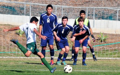 San Marcos' defensive wall cuts down the angles for Santa Barbara High's free kick.