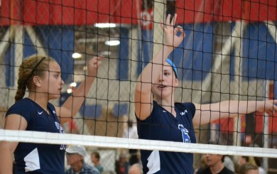 Dani Abrams, right, communicates the blocking plan with teammate Chloe Allen