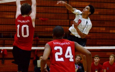 Evan Yoshimoto of SBCC hits past a Long Beach block. Yoshimoto had 18 kills in the match.