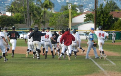SBCC players rush the field to celebrate after James Hill hit a sacrifice fly to score Connor McManigal with the game-winning run in the 10th inning.