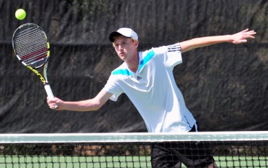 Cate senior Michael Revord takes a volley at the net during a doubles set in Wednesday's CIF match.