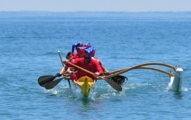 A canoe races towards the beach during one of Saturday's sprints.
