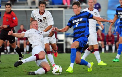 Westmont's Tanner Wolf, left, and UCSB's Drew Murphy challenge for a ball in the midfield.