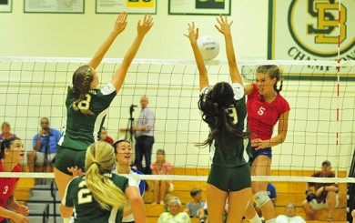 Santa Barbara blockers Katie Gallivan, left, and Jackie Starnes stop an attack by Emma Harrah of San Marcos.
