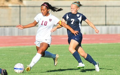 Westmont's Tiffany Dimaculangan and Concordia's Annika Hayman on Friday. Dimaculangan covered lots of ground in her full 90 minutes.